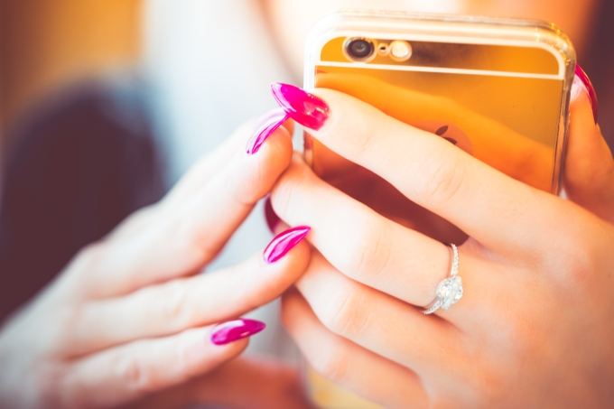 young-woman-using-her-gold-smartphone-picjumbo-com